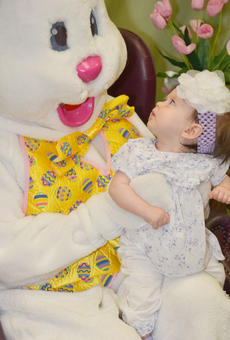 """<div class=""""source"""">Calen McKinney</div><div class=""""image-desc"""">Brooklyn Scanlon, 7 months, takes a long look at the Easter Bunny.</div><div class=""""buy-pic""""><a href=""""/photo_select/51221"""">Buy this photo</a></div>"""