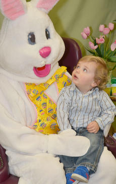 """<div class=""""source"""">Calen McKinney</div><div class=""""image-desc"""">Sam Heinecke, 18 months, sits in the Easter Bunny's lap, but gets a good look at him at the same time.</div><div class=""""buy-pic""""><a href=""""/photo_select/51222"""">Buy this photo</a></div>"""