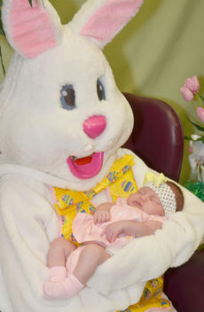 """<div class=""""source"""">Calen McKinney</div><div class=""""image-desc"""">Amaurie Benham, 4 weeks, sleeps during her photo session with the Easter Bunny.</div><div class=""""buy-pic""""><a href=""""/photo_select/51223"""">Buy this photo</a></div>"""
