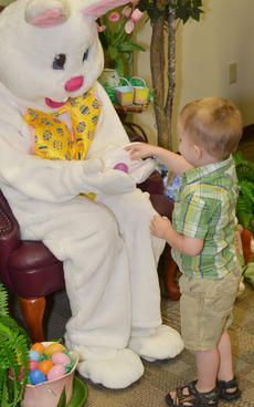 """<div class=""""source"""">Calen McKinney</div><div class=""""image-desc"""">Draven Skaggs, 2, wasn't quite comfortable with sitting in the Easter Bunny's lap. Instead, he gave the Easter Bunny some eggs from a basket.</div><div class=""""buy-pic""""><a href=""""/photo_select/51224"""">Buy this photo</a></div>"""