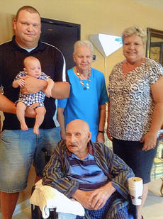 "<div class=""source""></div><div class=""image-desc"">Five generations of a local family gathered recently for a photo. Pictured are, from left, Adam Burress holding his son, Peyton Burress, 7 months, great-grandmother Rose Miller, grandmother Toni Burress, and, seated, Elmer Hatfield, great-great-grandfather.</div><div class=""buy-pic""></div>"