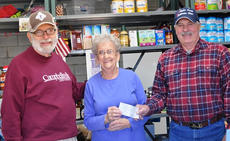 """<div class=""""source"""">Leslie Moore</div><div class=""""image-desc"""">Food Pantry volunteer Marietta Moyers, center, accepts the donation from Dan Flanagan, president of the farmers' market, left, and Mike Holzknecht, president of the cattlemen's association.</div><div class=""""buy-pic""""><a href=""""/photo_select/48881"""">Buy this photo</a></div>"""
