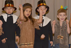 """<div class=""""source"""">Calen McKinney</div><div class=""""image-desc"""">From left, Toby Adams, Amy Gilbrech, Noah Spencer and Griffin Hines dance to a Thanksgiving song.</div><div class=""""buy-pic""""><a href=""""/photo_select/48662"""">Buy this photo</a></div>"""
