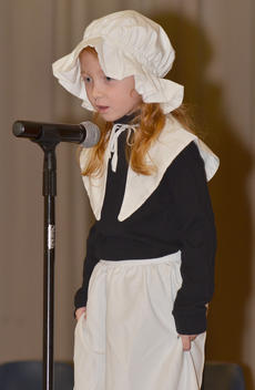 """<div class=""""source"""">Calen McKinney</div><div class=""""image-desc"""">Savannah Wethington tells the crowd how the Thanksgiving holiday began.</div><div class=""""buy-pic""""><a href=""""/photo_select/48663"""">Buy this photo</a></div>"""