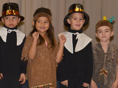 """<div class=""""source"""">Calen McKinney</div><div class=""""image-desc"""">From left, Toby Adams, Amy Gilbrech, Noah Spencer and Griffin Hines dance to a Thanksgiving song.</div><div class=""""buy-pic""""><a href=""""/photo_select/48665"""">Buy this photo</a></div>"""
