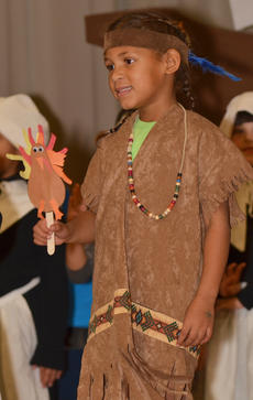 """<div class=""""source"""">Calen McKinney</div><div class=""""image-desc"""">Brianna Mitchell holds a handmade turkey during a song about Thanksgiving.</div><div class=""""buy-pic""""><a href=""""/photo_select/48655"""">Buy this photo</a></div>"""