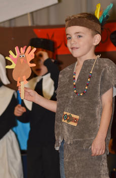 """<div class=""""source"""">Calen McKinney</div><div class=""""image-desc"""">Griffin Hines holds a handmade turkey during a song about Thanksgiving.</div><div class=""""buy-pic""""><a href=""""/photo_select/48656"""">Buy this photo</a></div>"""