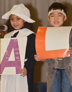 """<div class=""""source"""">Calen McKinney</div><div class=""""image-desc"""">Narissa Barnett, at left, and Kohei Hanada hold letters during a song about the fall season.</div><div class=""""buy-pic""""><a href=""""/photo_select/48657"""">Buy this photo</a></div>"""