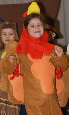 """<div class=""""source"""">Calen McKinney</div><div class=""""image-desc"""">Zehavah Negron portrays a turkey during the Thanksgiving musical.</div><div class=""""buy-pic""""><a href=""""/photo_select/48660"""">Buy this photo</a></div>"""