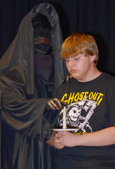 "<div class=""source"">Calen McKinney</div><div class=""image-desc"">The grim reaper extinguishes Austin Belt's candle as his obituary is read during Ghost Out at Campbellsville High School.</div><div class=""buy-pic""><a href=""/photo_select/51426"">Buy this photo</a></div>"