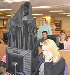 "<div class=""source"">Calen McKinney</div><div class=""image-desc"">The grim reaper walks around the Campbellsville High School library to see who will be his next victim.</div><div class=""buy-pic""><a href=""/photo_select/51436"">Buy this photo</a></div>"