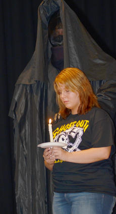 "<div class=""source"">Calen McKinney</div><div class=""image-desc"">The grim reaper touches Kaitlyn Bryant's shoulder as her obituary is read during Ghost Out at Campbellsville High School.</div><div class=""buy-pic""><a href=""/photo_select/51437"">Buy this photo</a></div>"