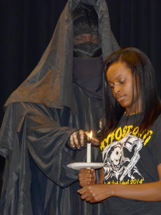 "<div class=""source"">Calen McKinney</div><div class=""image-desc"">The grim reaper extinguishes Iyonia Jackson's candle as her obituary is read during Ghost Out at Campbellsville High School.</div><div class=""buy-pic""><a href=""/photo_select/51427"">Buy this photo</a></div>"