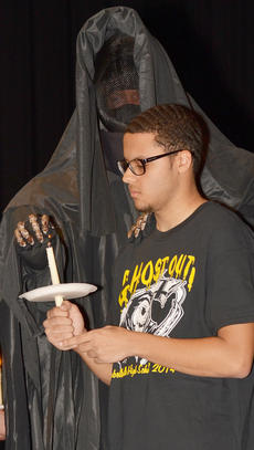 "<div class=""source"">Calen McKinney</div><div class=""image-desc"">The grim reaper extinguishes Malique Spaulding's candle as his obituary is read during Ghost Out at Campbellsville High School.</div><div class=""buy-pic""><a href=""/photo_select/51428"">Buy this photo</a></div>"