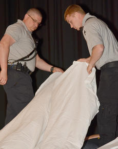 "<div class=""source"">Calen McKinney</div><div class=""image-desc"">Fire fighters Steve Marrs, at left, and James Abt cover another of the grim reaper's victims at Ghost Out at Campbellsville High School.</div><div class=""buy-pic""><a href=""/photo_select/51429"">Buy this photo</a></div>"