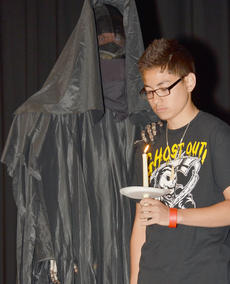 "<div class=""source"">Calen McKinney</div><div class=""image-desc"">The grim reaper touches Kern Kost's shoulder as his obituary is read during Ghost Out at Campbellsville High School.</div><div class=""buy-pic""><a href=""/photo_select/51430"">Buy this photo</a></div>"