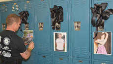 "<div class=""source"">Calen McKinney</div><div class=""image-desc"">Fire fighter Keith Bricken places photos and ribbons on lockers in honor of some of the grip reaper's victims during Ghost Out at Campbellsville High School.</div><div class=""buy-pic""><a href=""/photo_select/51435"">Buy this photo</a></div>"