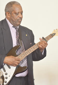 "<div class=""source"">Calen McKinney</div><div class=""image-desc"">The Rev. Joe Richardson plays guitar as Voices of Praise sing. </div><div class=""buy-pic""><a href=""/photo_select/50197"">Buy this photo</a></div>"