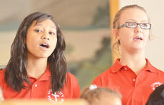 "<div class=""source"">Calen McKinney</div><div class=""image-desc"">Danielle Manning, at left, and Erica Cummings sing with the Community Youth Choir. </div><div class=""buy-pic""><a href=""/photo_select/50201"">Buy this photo</a></div>"