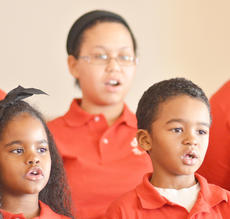 "<div class=""source"">Calen McKinney</div><div class=""image-desc"">Makyla Shively, at left, and her brother, Massiah, sing with the Community Youth Choir. </div><div class=""buy-pic""><a href=""/photo_select/50202"">Buy this photo</a></div>"