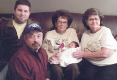 """<div class=""""source""""></div><div class=""""image-desc"""">Five generations of the Clarke family recently gathered for a family photo. They are, from left, father Corey Clarke, grandfather Joe Clarke, great-great-grandmother Cymbeline Shoffner holding Corey's daughter Carstyn Jenner Clarke, and great-grandmother Judy Clarke.</div><div class=""""buy-pic""""></div>"""