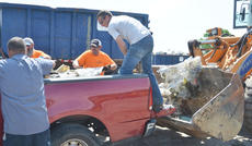 """<div class=""""source"""">Calen McKinney</div><div class=""""image-desc"""">County Road Department workers unload items from a truck. </div><div class=""""buy-pic""""><a href=""""http://web2.lcni5.com/cgi-bin/c2newbuyphoto.cgi?pub=085&orig=cleanup_1.jpg"""" target=""""_new"""">Buy this photo</a></div>"""