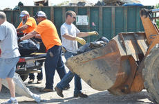 """<div class=""""source"""">Calen McKinney</div><div class=""""image-desc"""">County Road Department workers unload items from a truck.</div><div class=""""buy-pic""""><a href=""""http://web2.lcni5.com/cgi-bin/c2newbuyphoto.cgi?pub=085&orig=cleanup_7.jpg"""" target=""""_new"""">Buy this photo</a></div>"""