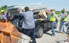 """<div class=""""source"""">Calen McKinney</div><div class=""""image-desc"""">City workers, from left, Mark Inman, Kenny Childers, Rodger Willis and Ricky Dickens unload mattresses from a truck.</div><div class=""""buy-pic""""><a href=""""http://web2.lcni5.com/cgi-bin/c2newbuyphoto.cgi?pub=085&orig=cleanup_8.jpg"""" target=""""_new"""">Buy this photo</a></div>"""