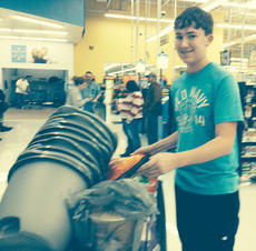 """<div class=""""source""""></div><div class=""""image-desc"""">Campbellsville Middle School Beta Club hosted a penny war, which raised $300 each to buy items for the Toys for Kids Program and Taylor County Animal Shelter. Pictured is Zack Settle with items for the animal shelter.</div><div class=""""buy-pic""""></div>"""