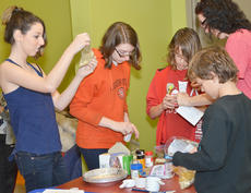 """<div class=""""source"""">Calen McKinney</div><div class=""""image-desc"""">The Heisler-Quinn family measures ingredients to make soup. From left are Page Zetzman, Alex Heisler-Quinn, Kanor Heisler-Quinn, Jennifer Heisler-Quinn and Zakk Heisler-Quinn. The Heisler-Quinn family is working at Amazon.com and is camping in Campbellsville.</div><div class=""""buy-pic""""><a href=""""/photo_select/49186"""">Buy this photo</a></div>"""