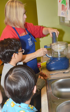 """<div class=""""source"""">Calen McKinney</div><div class=""""image-desc"""">Expanded Foods & Nutrition Program Assistant Angie Freeman from the Taylor County Extension Office shows her class how to use a food processor.</div><div class=""""buy-pic""""><a href=""""/photo_select/49188"""">Buy this photo</a></div>"""
