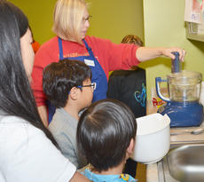 """<div class=""""source"""">Calen McKinney</div><div class=""""image-desc"""">Expanded Foods & Nutrition Program Assistant Angie Freeman from the Taylor County Extension Office shows her class how to use a food processor.</div><div class=""""buy-pic""""><a href=""""/photo_select/49184"""">Buy this photo</a></div>"""