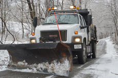 """<div class=""""source"""">Calen McKinney</div><div class=""""image-desc"""">County Road Department worker Josh Marcum drives a salt truck on Gravel Pit Road, which was still covered with snow and ice last Thursday afternoon after snow fell a few days earlier.</div><div class=""""buy-pic""""><a href=""""http://web2.lcni5.com/cgi-bin/c2newbuyphoto.cgi?pub=085&orig=county_salt_truck_7web.jpg"""" target=""""_new"""">Buy this photo</a></div>"""