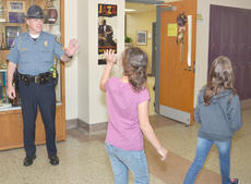 """<div class=""""source"""">Calen McKinney</div><div class=""""image-desc"""">Campbellsville Police officers will now be seen roaming the halls at Campbellsville Independent schools on a regular basis as part of the department's new """"Adopt a School"""" program. The program was begun to continue building rapport between officers and students and to serve as a resource for students and their teachers and parents. Above, Campbellsville Police Sgt. Shannon Wilson waves to Campbellsville Middle School students as he visits the school Friday morning.</div><div class=""""buy-pic""""><a href=""""/photo_select/51277"""">Buy this photo</a></div>"""