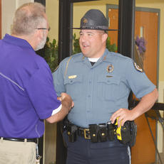 """<div class=""""source"""">Calen McKinney</div><div class=""""image-desc"""">Campbellsville Police Officer Ryan Jewell greets Campbellsville Middle School Assistant Principal Tim Bailey on Friday morning.</div><div class=""""buy-pic""""><a href=""""/photo_select/51278"""">Buy this photo</a></div>"""