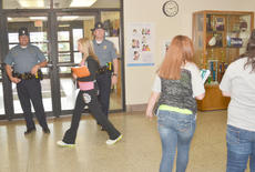 """<div class=""""source"""">Calen McKinney</div><div class=""""image-desc"""">Campbellsville Police Officer Ryan Jewell, at left, and Sgt. Shannon Wilson greet students at Campbellsville Middle School on Friday morning.</div><div class=""""buy-pic""""><a href=""""/photo_select/51279"""">Buy this photo</a></div>"""