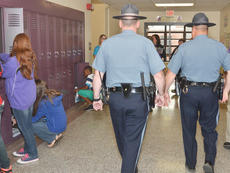 """<div class=""""source"""">Calen McKinney</div><div class=""""image-desc"""">Campbellsville Police Sgt. Shannon Wilson, at left, and Officer Ryan Jewell greet students at Campbellsville Middle School on Friday morning as they walk through the school during a visit.</div><div class=""""buy-pic""""><a href=""""/photo_select/51280"""">Buy this photo</a></div>"""