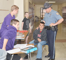 """<div class=""""source"""">Calen McKinney</div><div class=""""image-desc"""">Campbellsville Police Officer Ryan Jewell greets students at Campbellsville Middle School on Friday morning.</div><div class=""""buy-pic""""><a href=""""/photo_select/51281"""">Buy this photo</a></div>"""
