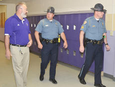 """<div class=""""source"""">Calen McKinney</div><div class=""""image-desc"""">Campbellsville Middle School Assistant Principal Tim Bailey talks to Campbellsville Police Officer Ryan Jewell, at left, and Sgt. Shannon Wilson on Friday morning as they walk through his school.</div><div class=""""buy-pic""""><a href=""""/photo_select/51282"""">Buy this photo</a></div>"""