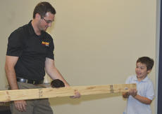 """<div class=""""source"""">Calen McKinney</div><div class=""""image-desc"""">Luke Durham, 6, of Campbellsville, prepares as this Norway rat named Hickory crawls near him. At left is Naturalist John Ham.</div><div class=""""buy-pic""""><a href=""""/photo_select/47825"""">Buy this photo</a></div>"""