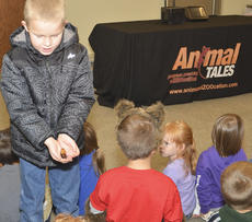 """<div class=""""source"""">Calen McKinney</div><div class=""""image-desc"""">Collin Moore of Campbellsville shows his friends a Madagascar hissing cockroach.</div><div class=""""buy-pic""""><a href=""""/photo_select/47828"""">Buy this photo</a></div>"""