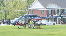 "<div class=""source"">Calen McKinney</div><div class=""image-desc"">Campbellsville Fire & Rescue personnel were critically injured at 11:42 a.m. Thursday after a ladder from a fire truck came near a power line and an electric arc of current struck the men. The incident took place on the Campbellsville University campus while the firefighters were helping CU band students with the ALS cold water challenge.</div><div class=""buy-pic""><a href=""http://web2.lcni5.com/cgi-bin/c2newbuyphoto.cgi?pub=085&orig=cu-firefighter_scene_12.jpg"" target=""_new"">Buy this photo</a></div>"