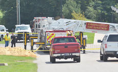 "<div class=""source"">Calen McKinney</div><div class=""image-desc"">Campbellsville Fire & Rescue personnel were critically injured at 11:42 a.m. Thursday after a ladder from a fire truck came near a power line and an electric arc of current struck the men. The incident took place on the Campbellsville University campus while the firefighters were helping CU band students with the ALS cold water challenge.</div><div class=""buy-pic""><a href=""http://web2.lcni5.com/cgi-bin/c2newbuyphoto.cgi?pub=085&orig=cu-firefighter_scene_16.jpg"" target=""_new"">Buy this photo</a></div>"
