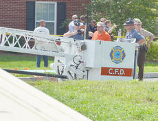 "<div class=""source"">Calen McKinney</div><div class=""image-desc"">Campbellsville Fire & Rescue personnel were critically injured at 11:42 a.m. Thursday after a ladder from a fire truck came near a power line and an electric arc of current struck the men. The incident took place on the Campbellsville University campus while the firefighters were helping CU band students with the ALS cold water challenge.</div><div class=""buy-pic""><a href=""http://web2.lcni5.com/cgi-bin/c2newbuyphoto.cgi?pub=085&orig=cu-firefighter_scene_2.jpg"" target=""_new"">Buy this photo</a></div>"