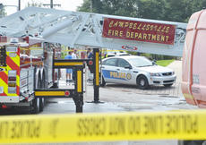 "<div class=""source"">Calen McKinney</div><div class=""image-desc"">Campbellsville Fire & Rescue personnel were critically injured at 11:42 a.m. Thursday after a ladder from a fire truck came near a power line and an electric arc of current struck the men. The incident took place on the Campbellsville University campus while the firefighters were helping CU band students with the ALS cold water challenge.</div><div class=""buy-pic""><a href=""http://web2.lcni5.com/cgi-bin/c2newbuyphoto.cgi?pub=085&orig=cu-firefighter_scene_5.jpg"" target=""_new"">Buy this photo</a></div>"