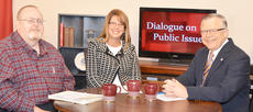 """<div class=""""source"""">Drew Tucker</div><div class=""""image-desc"""">From left, Dr. Damon Eubank, Dr. Wendy Davis and John Chowning talk about the JFK assassination on """"Dialogue on Public Issues.""""</div><div class=""""buy-pic""""></div>"""