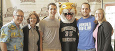 "<div class=""source"">Robert Bender</div><div class=""image-desc"">Aaron Smith, center, will attend Campbellsville University in the fall. He is surrounded by CU alumni and his parents, from left, Dave and Denise Gray Smith, Clawz, the Tiger mascot, Adam Smith, Dave and Denise Smith's son, and Adam's wife, Kristina Critcher Smith.</div><div class=""buy-pic""></div>"