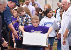 "<div class=""source"">Zac Oakes</div><div class=""image-desc"">Campbellsville Elementary School student Cameron Estes places a box of items in the time capsule, which is set to be opened in 50 years</div><div class=""buy-pic""><a href=""/photo_select/66181"">Buy this photo</a></div>"