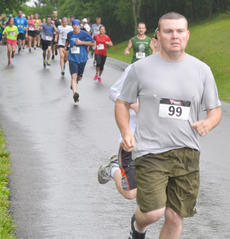 "<div class=""source"">Calen McKinney</div><div class=""image-desc"">Runners take off in the rain.</div><div class=""buy-pic""><a href=""http://web2.lcni5.com/cgi-bin/c2newbuyphoto.cgi?pub=085&orig=dam_runner_4.jpg"" target=""_new"">Buy this photo</a></div>"