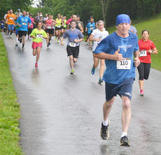 "<div class=""source"">Calen McKinney</div><div class=""image-desc"">Runners take off in the rain.</div><div class=""buy-pic""><a href=""http://web2.lcni5.com/cgi-bin/c2newbuyphoto.cgi?pub=085&orig=dam_runner_5.jpg"" target=""_new"">Buy this photo</a></div>"